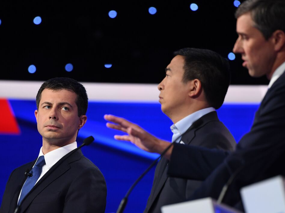Democratic presidential hopeful Mayor Pete Buttigieg looks on as former Texas Rep. Beto O'Rourke speaks during the fourth Democratic primary debate of the 2020 presidential campaign season on Tuesday. (Saul Loeb/AFP via Getty Images)