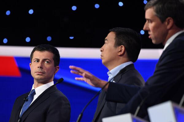 Democratic presidential hopeful Mayor Pete Buttigieg of South Bend, Ind., left, and entrepreneur Andrew Yang, center, listen as former Texas Rep. Beto O'Rourke speaks during the fourth Democratic primary debate.