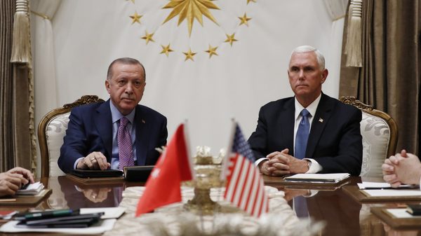 Vice President Mike Pence meets with Turkish President Recep Tayyip Erdogan at the Presidential Palace for talks on the Kurds and Syria on Thursday in Ankara, Turkey.