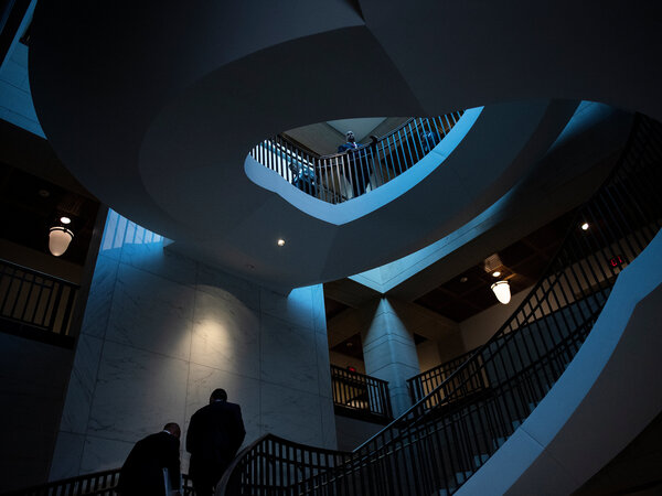 People walk on stairs on Capitol Hill Thursday as the House Intelligence Committee held a closed-door deposition of Ambassador Gordon Sondland.
