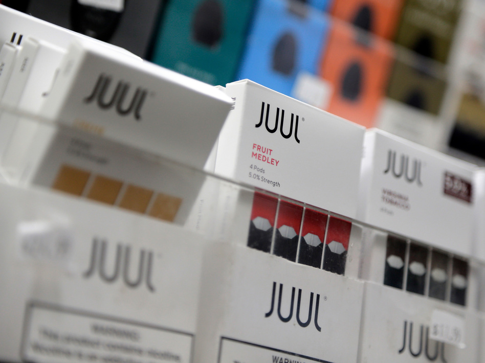 Juul announced it will suspend sales of all non-tobacco, non menthol-based flavors of its e-cigarette products. (Seth Wenig/AP)
