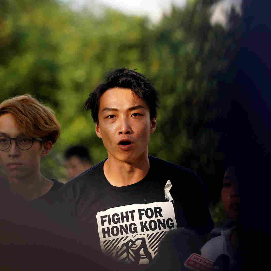 Westlake Legal Group rts2i8br-1-_sq-316edf50d809b9a6c3993e5b3942984a7bd4b065-s1100-c15 Prominent Hong Kong Protest Leader Beaten By Unknown Assailants