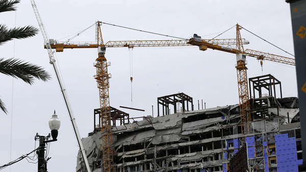 The two unstable cranes at the Hard Rock Hotel collapse site will be brought down by a controlled explosion.
