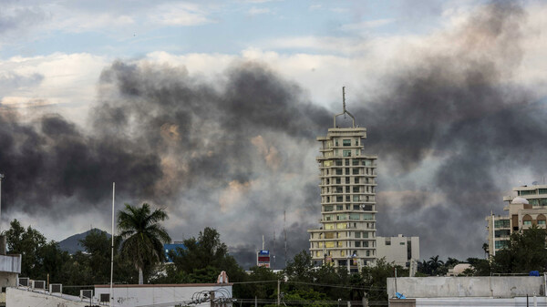 Smoke from burning cars rises in Culiacán, Mexico, on Thursday, after an intense gunfight between security forces and gunmen linked to the Sinaloa drug cartel.