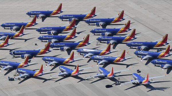 All Boeing 737 Max aircraft are grounded while the manufacturer fixes a deadly defect in their flight control system. These Southwest Airlines planes were  parked in Victorville, Calif., in March.
