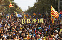 Protesters wave Catalan independence flags in the street in Barcelona, Spain, on Friday, following a week of demonstrations over the prison sentences given to separatist politicians by Spain's Supreme Court.