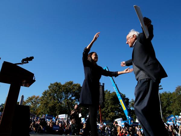 Sanders hugs Rep. Alexandria Ocasio-Cortez during last Saturday's campaign rally in Queens.