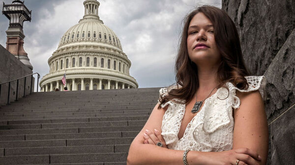 Brittany Kaiser, former employee of Cambridge Analytica, stands near the Capitol building in Washington, D.C. on July 31.
