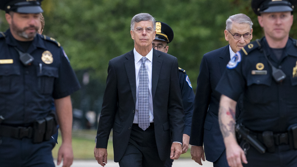 Acting Ambassador William Taylor is escorted by U.S. Capitol Police on Tuesday as he arrives to testify before House committees as part of the Democrats' impeachment inquiry into President Trump. (J. Scott Applewhite/AP)