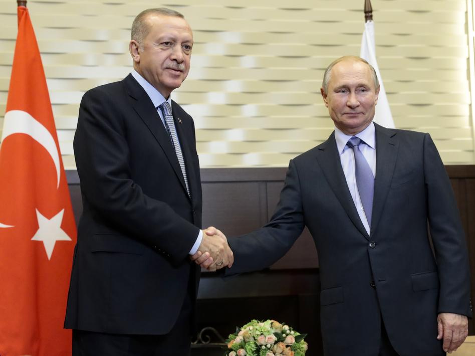 Russian President Vladimir Putin (right) and Turkish President Recep Tayyip Erdogan pose for a photo during their meeting in Sochi, Russia, Tuesday. (Sergei Chirikov/AP)