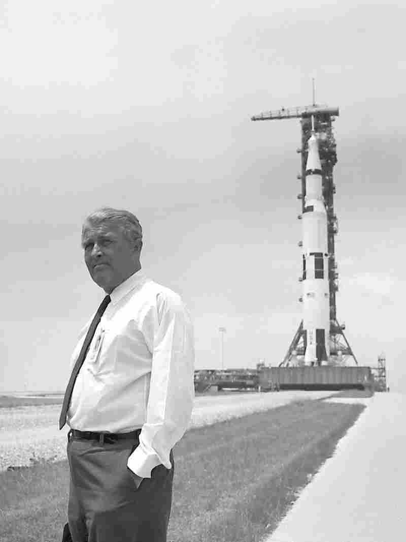 Dr. Wernher von Braun with the Apollo 11 spacecraft In the background. von Braun was a major contributor to the mission by developing the Saturn V rocket that helped land mankind on the moon.