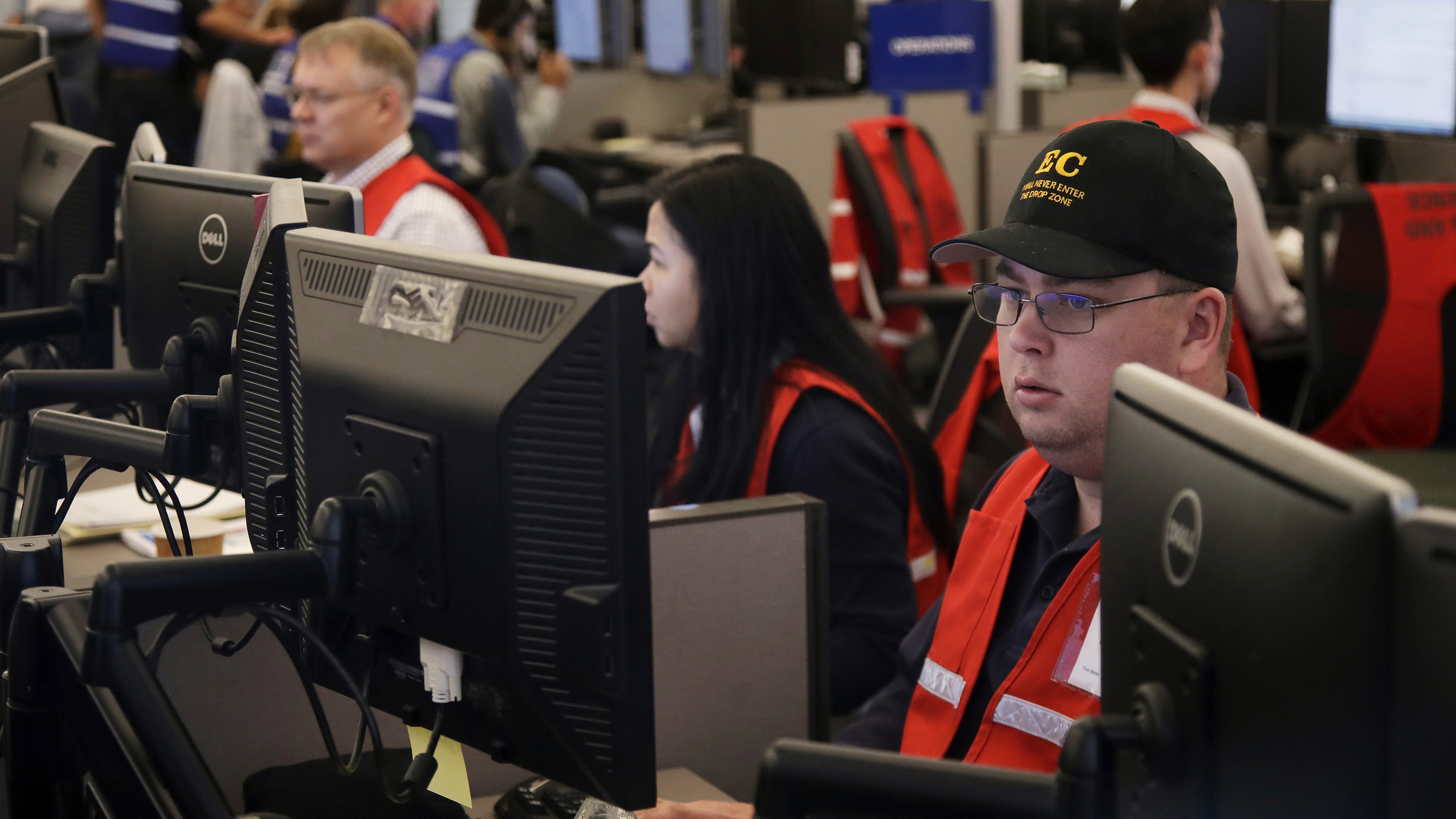 Pacific Gas & Electric employees work in the PG&E Emergency Operations Center in San Francisco. Authorities say power outages have started again in parts of Northern California.