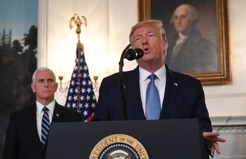 President Trump speaks about Syria in the Diplomatic Reception Room at the White House on Wednesday as Vice President Pence listens. (Saul Loeb/AFP via Getty Images)