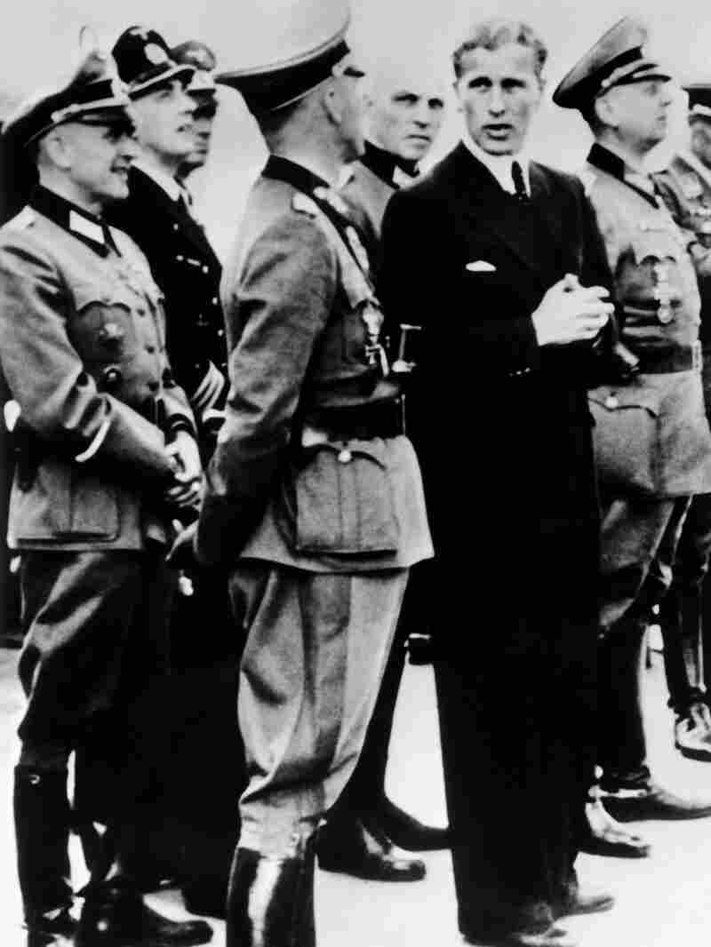 Wernher von Braun, technical director at the Army Rocket Center at Peenemünde, meets Nazi officers during a launch of the V-2 rocket, on June 20, 1944 in Germany.