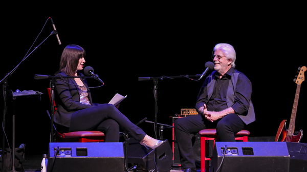 Host Ophira Eisenberg with Michael McDonald on Ask Me Another at the Lobero Theatre in Santa Barbara, California.