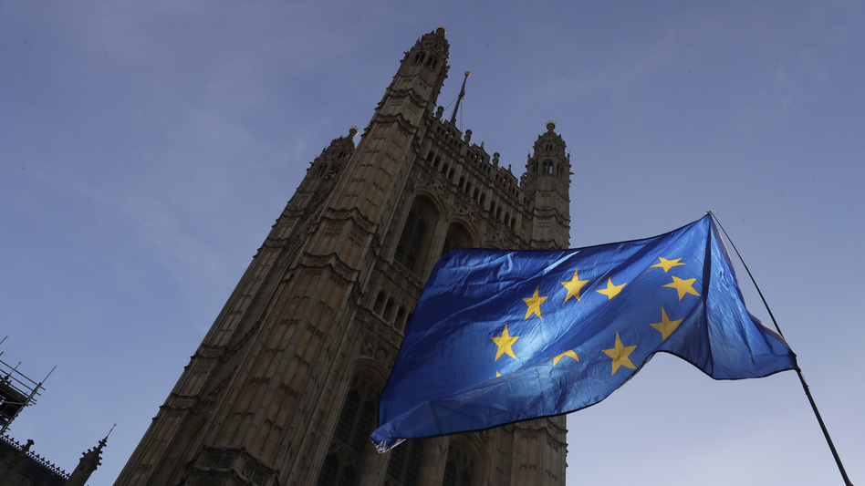 A European Union flag flies Monday outside the Parliament building in London. The multinational bloc has agreed to grant the U.K. another Brexit delay, bumping the deadline to the end of January. (Kirsty Wigglesworth/AP)