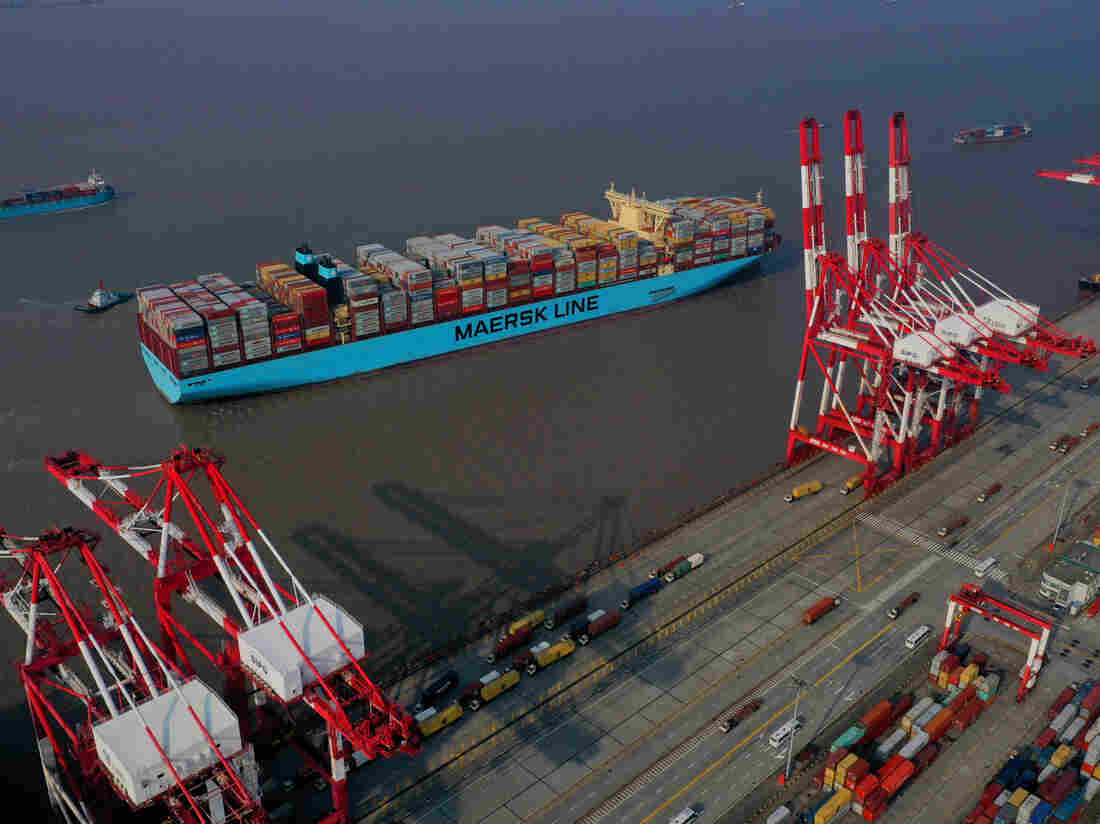 SHANGHAI, CHINA - OCTOBER 04: Tugboats guide a container ship of Maersk Line at the Yangshan Deepwater Port, operated by Shanghai International Port ( Group) Co., Ltd. (SIPG), on October 4, 2019 in Shanghai, China. (Photo by Ji Haixin/VCG via Getty Images)