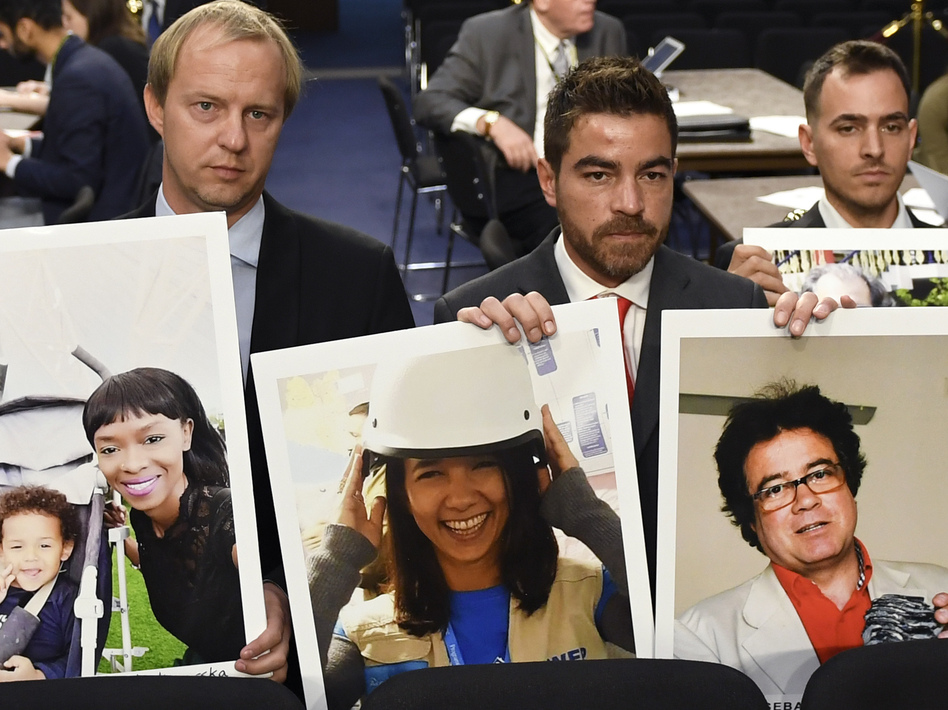 Family members hold photos of victims killed on Ethiopian Airlines Flight 302 and Lion Air Flight 610 on Tuesday. (Susan Walsh/AP)