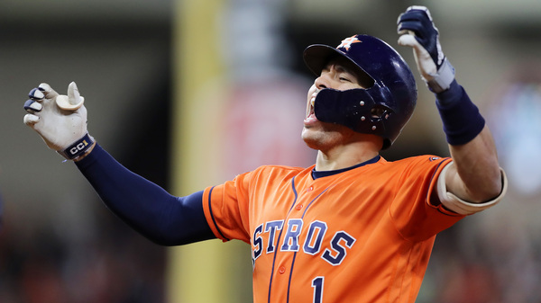 Carlos Correa celebrates after hitting an RBI single for the Houston Astros against the Washington Nationals during the fifth inning in Game 7 of the World Series.