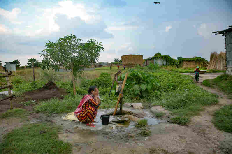 A woman bathes on a char near Rajshahi, Bangladesh.