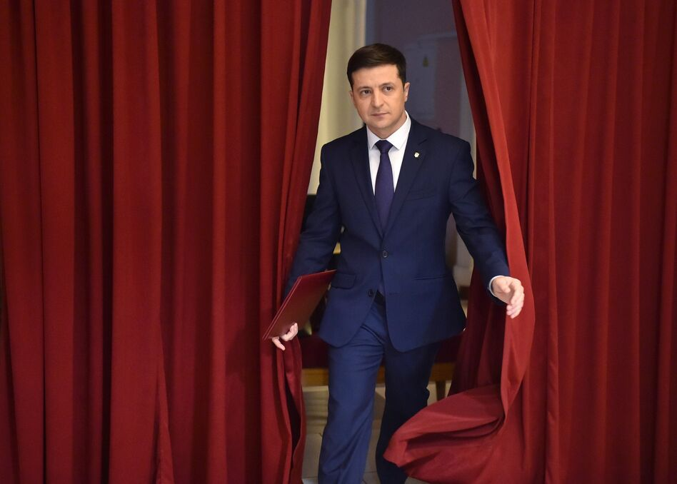 Volodymyr Zelenskiy enters a hall in Kyiv on March 6 to take part in the taping of the television series <em>Servant of the People. </em>His role on the show was as a fictional president of Ukraine. (Sergei Supinsky/AFP/Getty Images)