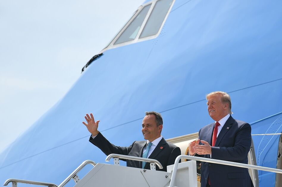 President Trump has been campaigning for Kentucky Republican Gov. Matt Bevin (left), who is on the ballot for reelection Tuesday. Above, they step off Air Force One in August at Louisville, Ky.'s airport. (Mandel Ngan/AFP/Getty Images)