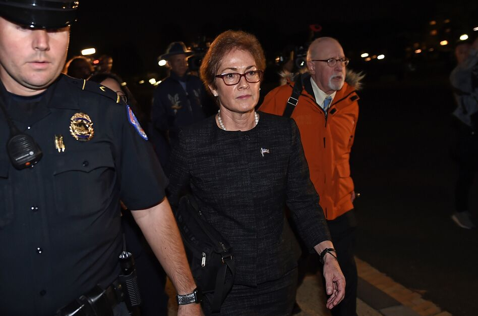Former U.S. Ambassador to Ukraine Marie Yovanovitch, flanked by lawyers, aides and Capitol police, leaves the Capitol on Oct. 11 after testifying behind closed doors to the House Intelligence, Foreign Affairs and Oversight committees as part of the ongoing impeachment investigation into President Trump. (Olivier Douliery/AFP via Getty Images)