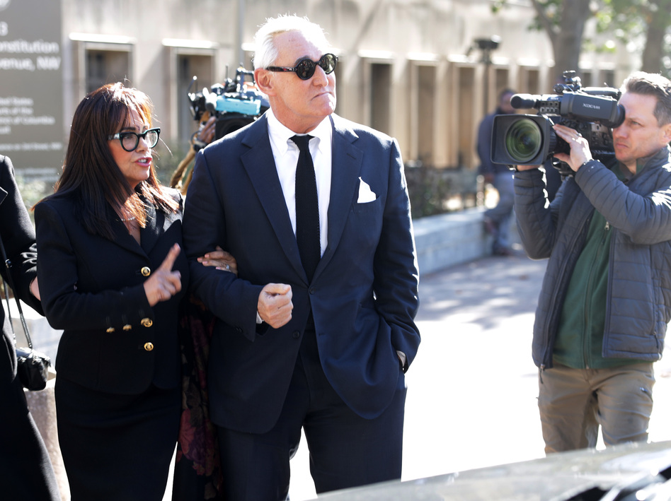 Roger Stone, a former adviser to President Trump, departs a Washington, D.C., courthouse with his wife on Monday. Stone faces charges that he allegedly lied to Congress and obstructed an official proceeding. Stone has pleaded not guilty, and his trial is set to begin Tuesday. (Alex Wong/Getty Images)