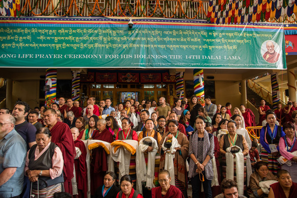 Buddhists from around the world carry gifts and offerings for the Dalai Lama during a ceremony devoted to prayers for his longevity in Dharamsala.