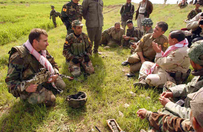 Kurdish Peshmerga fighters and U.S. special forces prepare for advancement into northern Iraq on April 3, 2003.