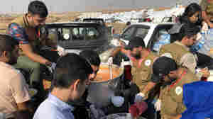 Syrian Kurdish Refugees Say Kurdish Forces Tried To Prevent Them From Fleeing To Iraq