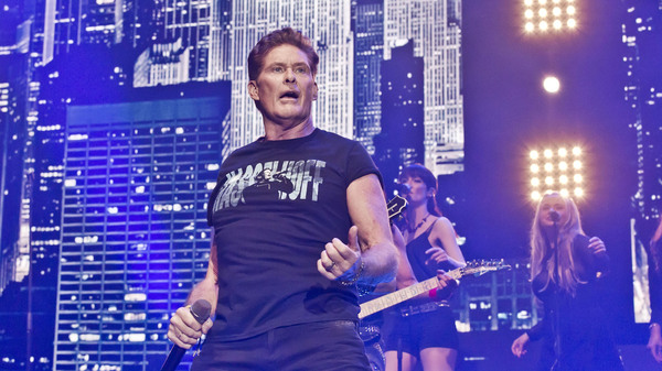 "David Hasselhoff performs during a concert in Berlin on Oct. 3 — Germany Unity Day. In 1989, his song ""Looking for Freedom"" was the anthem to many Germans"