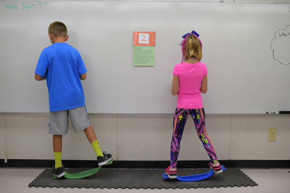 "Two fourth-graders rock side to side while doing math equations at Charles Pinckney Elementary School's ""Brain Room"" in Charleston, S.C., in 2015. (John McDonnell/The Washington Post/Getty Images)"