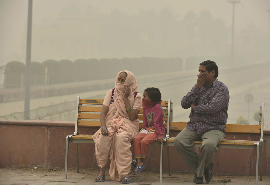 People cover their faces with masks to avoid thick smog in New Delhi on Nov. 5. People living there have complained about respiratory problems. (Raj K Raj/Hindustan Times/Getty Images)