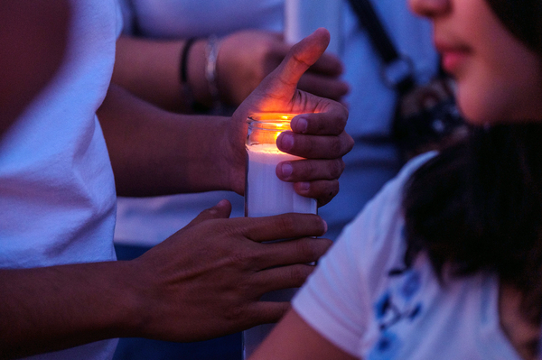 Mourners hold candles as they gather for a vigil at a memorial outside Cielo Vista Walmart in El Paso, Texas, U.S., on Wednesday, Aug. 7, 2019.