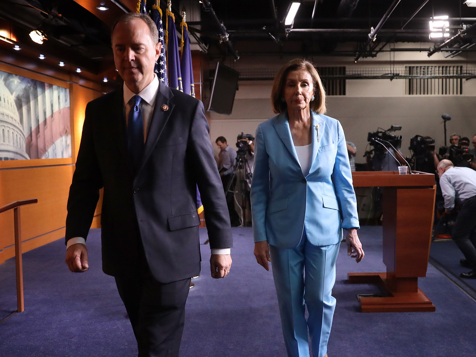 Speaker of the House Nancy Pelosi, D-Calif., and Rep. Adam Schiff, D-Calif., depart a press conference at the Capitol on Oct. 2. The impeachment inquiry enters a new phase this week with the start of public hearings. (Win McNamee/Getty Images)