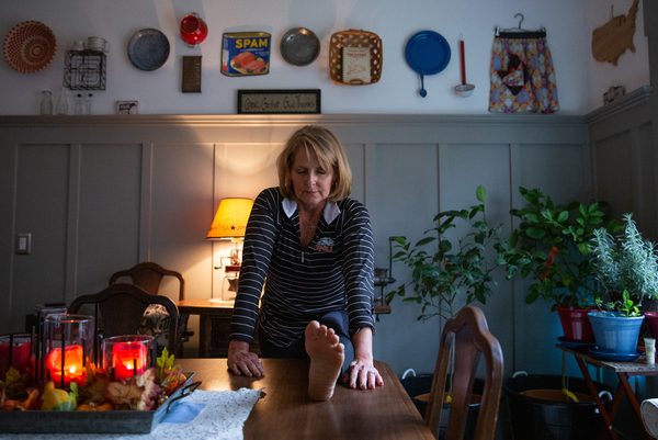 To deal with chronic pain, Pamela Bobb's morning routine now includes stretching and meditation at home in Fairfield Glade, Tenn. Bobb says this mind-body awareness and intervention has greatly reduced the amount of painkiller she needs.