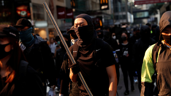 Protesters attend a demonstration in Hong Kong on Monday, as clashes intensified between pro-democracy activists and police.