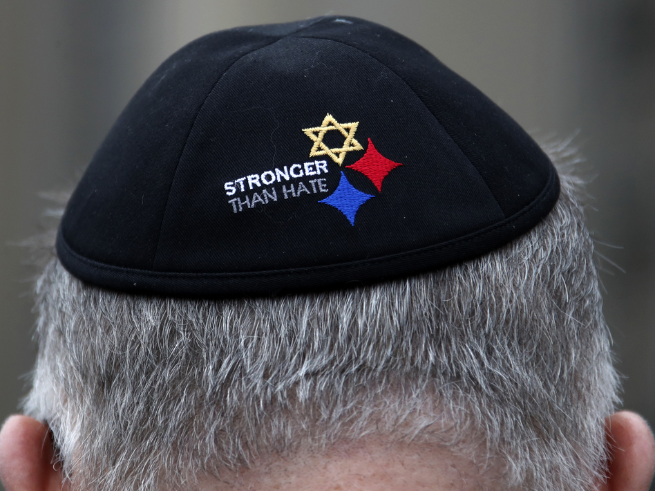 A man wearing a Stronger Than Hate yarmulke stands outside the Tree of Life synagogue in Pittsburgh, the site of a shooting that killed 11 worshippers in 2018. Anti-Semitic homicides in the U.S. reached their highest level ever as a result of the shooting. (Gene J. Puskar/AP)