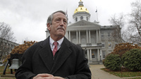 Former South Carolina Gov. Mark Sanford speaks during a news conference in front of the Statehouse on Tuesday in Concord, N.H., where he announced he is ending his longshot 2020 presidential bid.