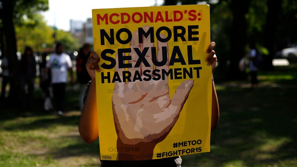 A McDonald's employee holds a sign during a 2018 protest against sexual harassment in the workplace in Chicago. (Joshua Lott/AFP via Getty Images)