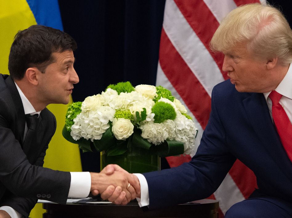 President Trump and Ukrainian President Volodymyr Zelenskiy shake hands during a meeting in New York on Sept. 25, on the sidelines of the United Nations General Assembly. (Saul Loeb/AFP via Getty Images)