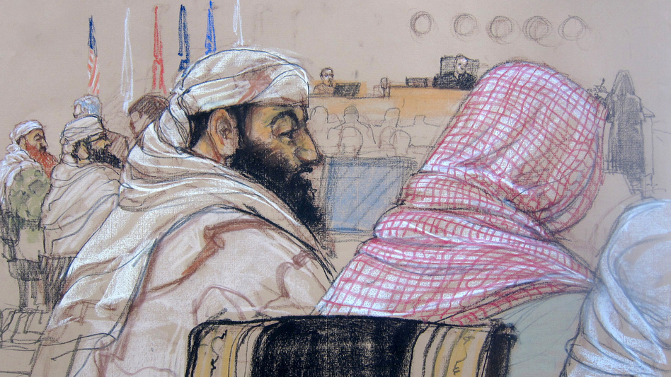 In this Pentagon-approved courtroom sketch, defendant Ramzi Binalshibh (center) attends his pretrial hearing along with other defendants at the U.S. military court in Guantánamo Bay, Cuba, on April 14, 2014. Also depicted are Mustafa al-Hawsawi (from right), partially cut off; Ali Abdul Aziz Ali, Ramzi Binalshibh, Walid bin Attash and Khalid Sheikh Mohammed. (Janet Hamlin Illustration/AP)