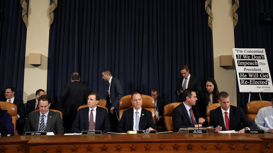 Daniel Goldman, attorney and director of investigations with the House Intelligence Committee (second from left); committee Chairman Adam Schiff, D-Calif; ranking member Rep. Devin Nunes, R-Calif.; and Steve Castor, counsel for the minority, hold the first public hearing of the impeachment inquiry on Capitol Hill on Wednesday. (Drew Angerer/Getty Images)
