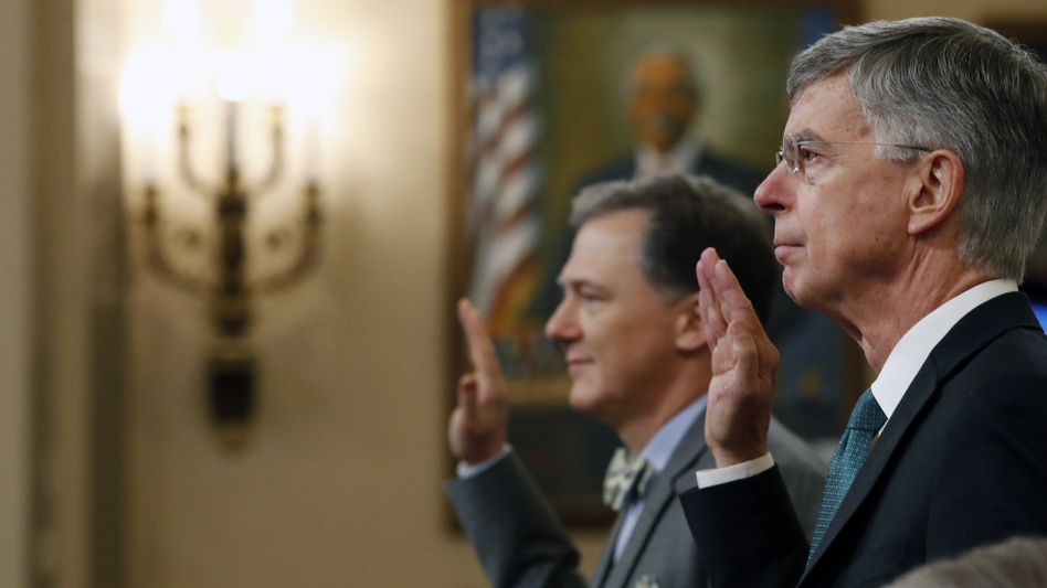 Top U.S. diplomat to Ukraine William Taylor (right) and Deputy Assistant Secretary for European and Eurasian Affairs George Kent are sworn in to testify before the House Intelligence Committee on Wednesday. (Alex Brandon/Pool/Getty Images)