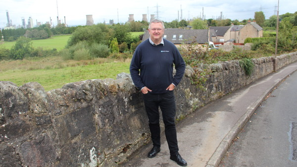 Kevin Ross, president of the Scottish Plastic and Rubber Association, in front of the INEOS Grangemouth refinery and chemical plant.