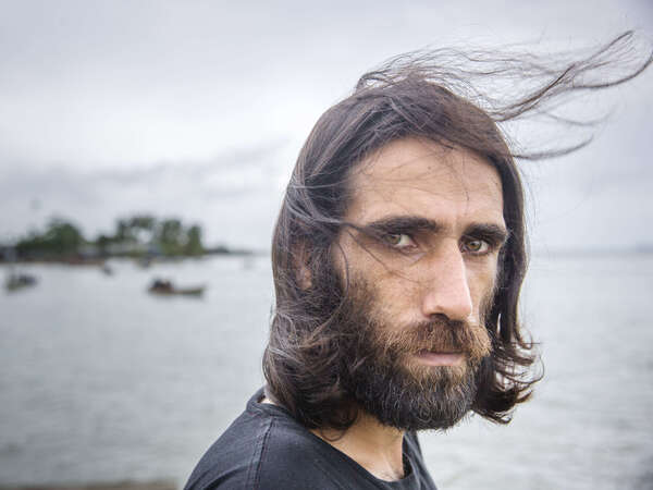 Behrouz Boochani, seen last year at the Australian detention center on Manus Island, Papua New Guinea, where the Kurdish-Iranian asylum-seeker spent years seeking his freedom. On Thursday, the prize-winning author touched down in New Zealand on his way to a literary festival — free for the first time in six years.