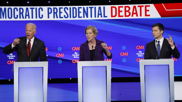 Democratic presidential candidates former Vice President Joe Biden (left), Sen. Elizabeth Warren, D-Mass., and South Bend, Ind., Mayor Pete Buttigieg (right) debate different ways to expand health coverage in America.