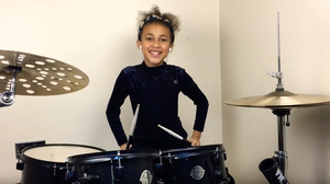 Watch This 9-Year-Old Girl Drum Her Heart Out To Nirvana's 'In Bloom'
