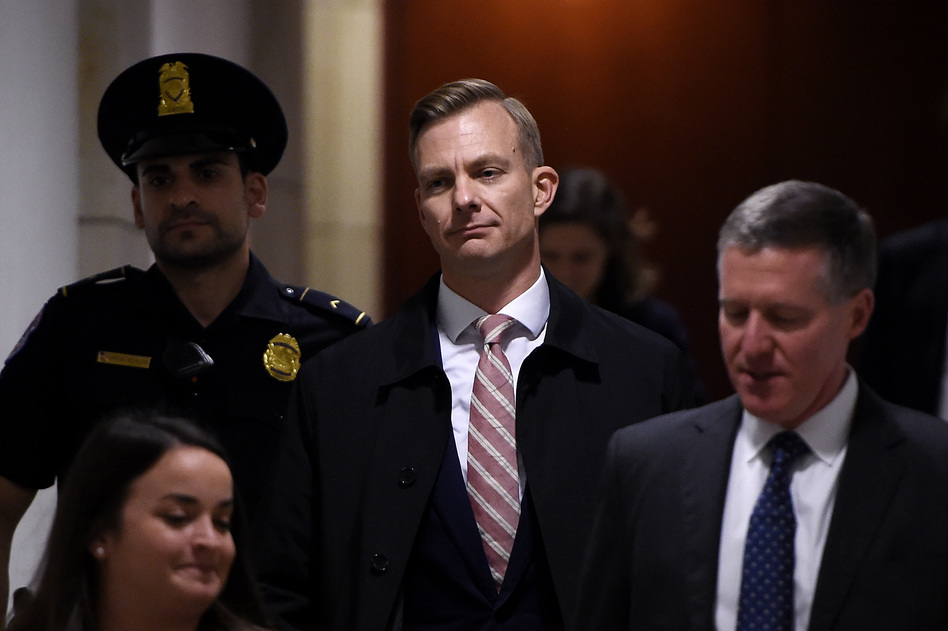 David Holmes, a State Department official, arrives to a closed-door deposition in the House impeachment inquiry. (Olivier Douliery/AFP via Getty Images)